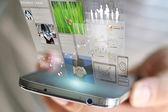 Businessman working on virtual screen. — Stock Photo