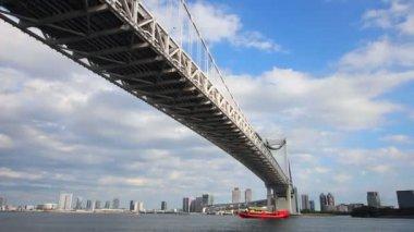 Under rainbow bridge at tokyo bay zoom shot — Stock Video