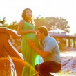 Happy young man kisses his pregnant wife belly — Stock Photo #51868163