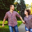 Happy couple in love running at alley. Toned image — Stock Photo #51879841