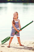 Happy girl with paddle at beach. toned image — Stock Photo