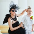 Moter with son playing angel and demon — Stock Photo #52095443