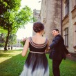 Happy couple in love walking at alley. Toned image — Stock Photo #52095469