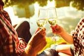 Man and woman clanging wine glasses with champagne — Stock Photo