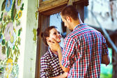 Couple in love at the old house. toned image — Stock Photo