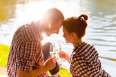 Man and woman clanging wine glasses with champagne — 图库照片