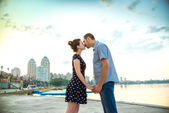 Happy young couple kissing in the city — Stock Photo