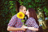 Beautiful kissing happy couple in love — Stock Photo