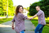 Happy couple in love running at alley — Stock Photo