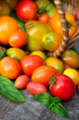 Multicolored tomatoes on wooden background — Stockfoto
