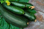 Fresh organic zucchini on the wooden table — Stockfoto