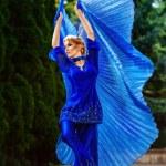 Beautiful woman. Waving fabric wings. Toned image — Stock Photo #57109395