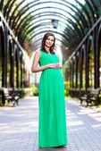 Beautiful pregnant woman feeling lovely — Stock Photo