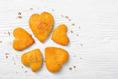 Heart-shaped cookies on wooden background. — Stock Photo
