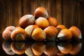 Raw Organic Whole Hazelnuts on wooden background. Selective focus — Stock Photo
