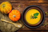 Homemade Autumn Butternut Squash Soup rustic wooden table — Stock Photo