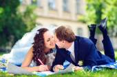 Toned photo of Happy man and woman colouring or drawing hearts at the garden. Love concept. — Stock Photo