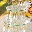 Pyramid of champagne glasses during catering at party — Stock Photo #65026999