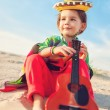 Toned photo of Little happy smiling boy plays his guitar or ukulele — Stock Photo #65027017