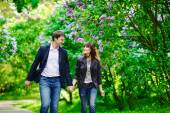 Happy couple in love walking at alley — Stock Photo