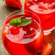 Coctail. Refreshing summer drink with Strawberry in two glasses on rustic wooden table — Stock Photo #72681549