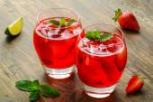 Cold strawberries drinks with strawberry slices and mint — Stock Photo