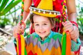 Smiling little boy holding his mother braids — Stock Photo