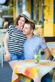 Happy couple drinking lemonade or mojito in an outside cafe — Stock Photo