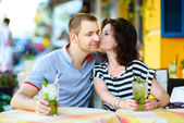 Young couple at cafe enjoying the time in holiday — Stock Photo