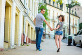 Happy couple in love walking at city — Stock Photo