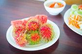 Rambutan on the plate — Stock Photo