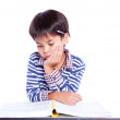 A young boy doing homework on a white background. — Stock Photo #52846397