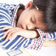 A young boy doing homework on a white background. — Stock Photo #52846493