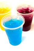 Sweet fruit juice in plastic glass — Stockfoto