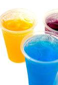 Sweet fruit juice in plastic glass — Stock Photo