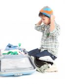 Boy with a suitcase is standing — Stock Photo