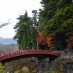 Ancient Japanese red arc bridge and Autumn leaves in Senda Japan — Stock Photo #77097285