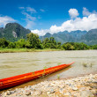 Surreal landscape by the Song river at Vang Vieng, Laos — Stock Photo #55523087