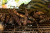 Grilled sweet potato on charcoal grill — Stock Photo