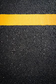 Yellow line on the new road — Stock Photo