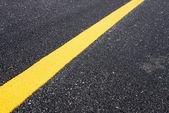 Yellow line on the new road  — Fotografia Stock
