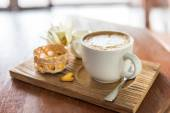 A cappuccino and some biscuits on the table — Stock Photo