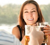 Young smiling woman drinking a glass of draft beer — Stock Photo
