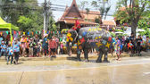 Songkran Festival is celebrated in a traditional New Year is Day from April 13 to 15, with the splashing water with elephants in Ayutthaya, Thailand. — Stock Photo