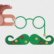 Hand catch glasses and mustache decorated by Christmas concept — Stock Photo #55461957