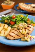 Chicken with pineapple salsa — Stock Photo