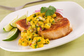 Swordfish with mango salsa — Stock Photo