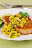 Swordfish with mango salsa — Stock Photo