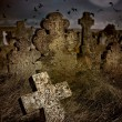 Halloween terrible Cemetery with old gravestones crosses, the moon and a flock of crows — Stock Photo #54963507