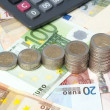 Diagram of coins on euro banknotes — Stock Photo #60441589
